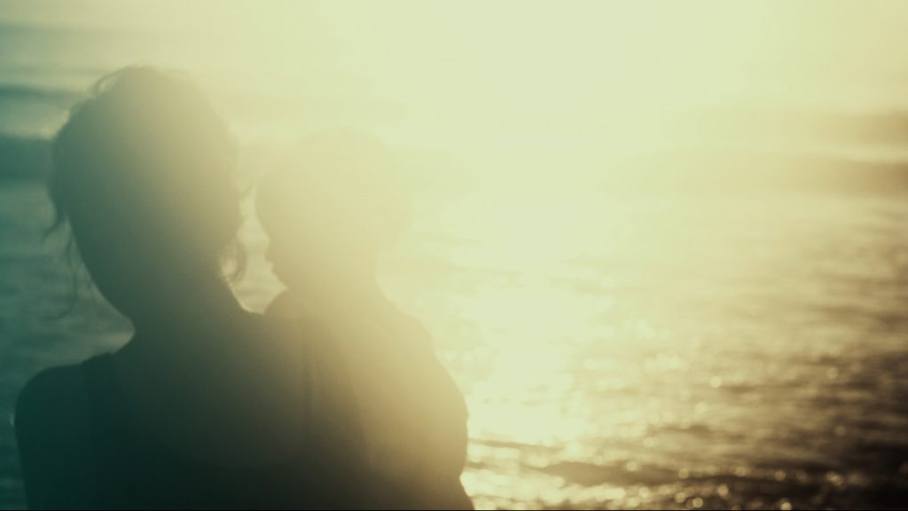 silhouette of woman and child