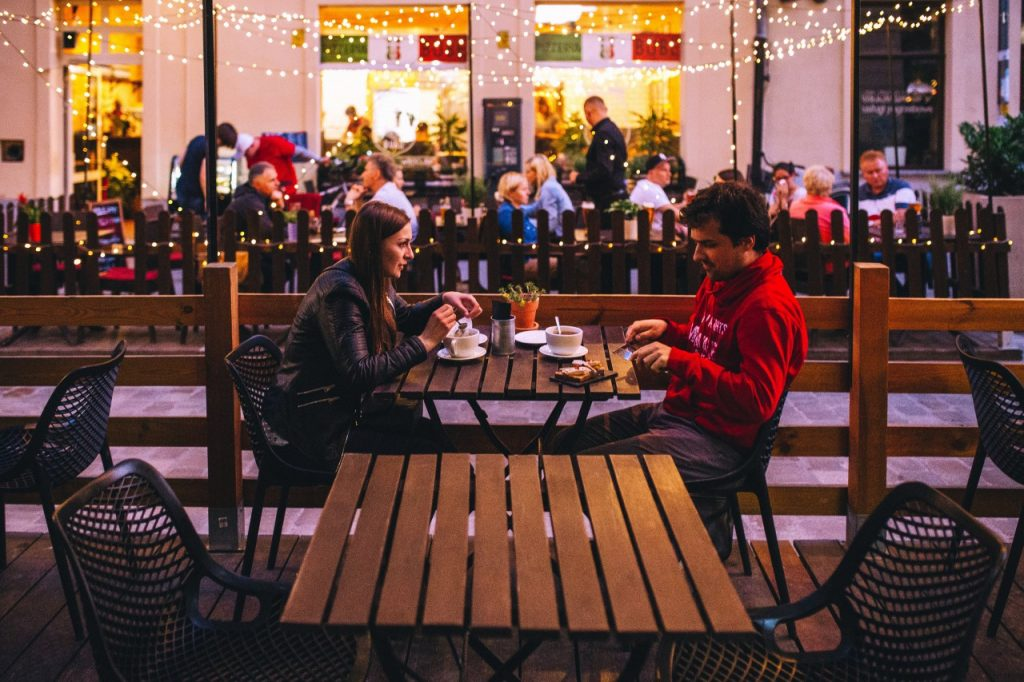 Man and woman sitting in outside eating area
