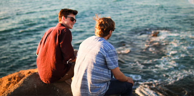 Picture of two guys talking in front of the ocean