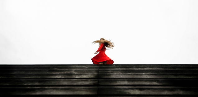 a girl twirling in a red dress