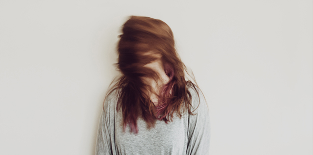 A woman flipping her hair around