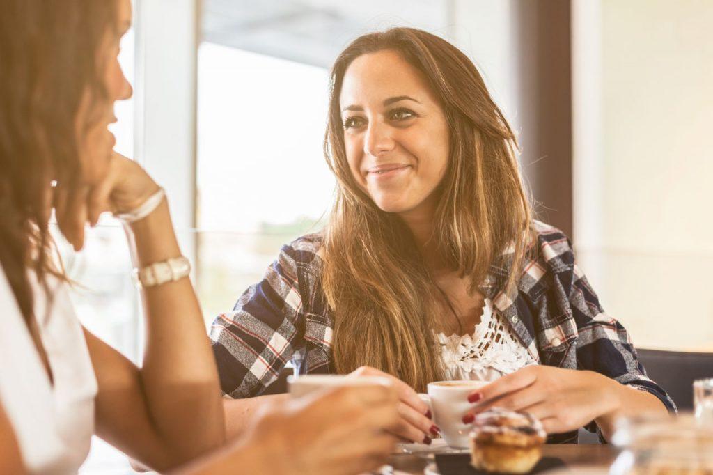 women talking at a coffee shop