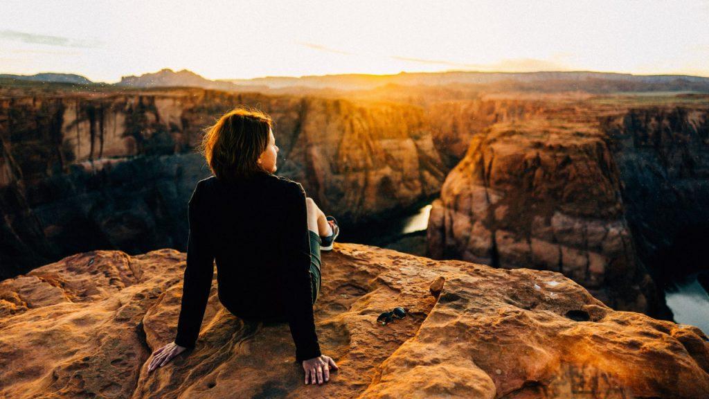woman sitting at horseshoe bend