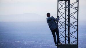 man on radio tower