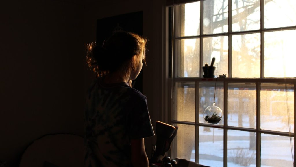 woman looking out window