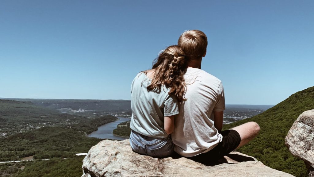 Janson and I on a rock overlooking a city - boundaries